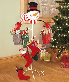 Love this alternate way of hanging stockings....or even gift bags :)
