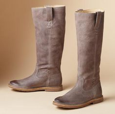 Frye® does a love-always, wear-forever basic in a fresh new color—a muted gray that looks good with everything. Distressed leather with X-stitching at top and bottom of shaft, pull tabs and a well-weathered toe. Leather lining, rubber lug sole. Imported. Whole and half sizes 6 to 10, 11. These are running 1/2 size smaller.View our entire Frye Collection.