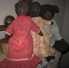 Early Black Doll with Red Dress -