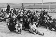 """""""Romani people wait at the Bełżec concentration camp in Poland. Note that 8/2 is International Porrajmos Remembrance Day. The precise number of Romani people killed in the Porrajmos (Holocaust) is not well-documented, but is estimated to be at least 220k. At Auschwitz, the Romani were kept separate from other prisoners in the """"Gypsy Family Camp"""". On 8/2/1944, the Nazis """"liquidated"""" at least 3k people. Elie Wiesel described the event in his book Night."""""""