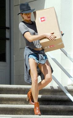 Stopping by the post office to pick up a package, the actress keeps it cool in Daisy Dukes.