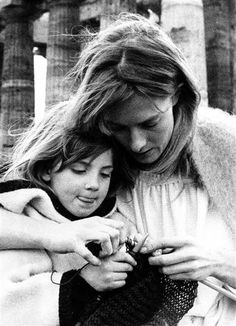 Natasha Richardson practices her knitting under the tutelage of her mother, actress Vanessa Redgrave, in 1968 in Rome