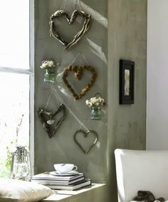 A collection of driftwood hearts as wall decor.