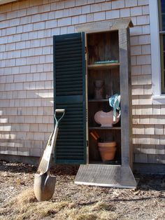 Nice small tool shed just for tools from upcycled wood and a shutter for the door.