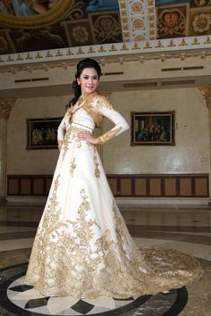 Kebaya Long in large trail with flower bordir with a gold color.is like european dresses but this original kebaya from indonesia.want it?