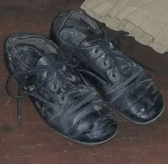 Early Black Earthy Shoes worn by a very sweet child and lovingly preserved by his Mother.............