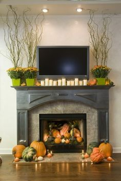 love the fall decorations with the pumpkins and twigs.