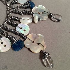 Bohemian mother of pearl button and sterling silver necklace.  Love how the buttons are used.
