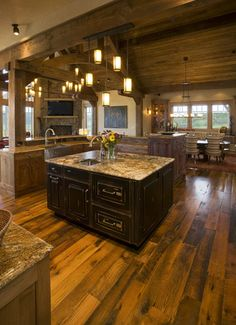 Love the dark stain on the cabinets, granite countertop and color the wood floor is stained! <3