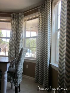 DIY curtain rods for bay windows - oh and love the curtains!