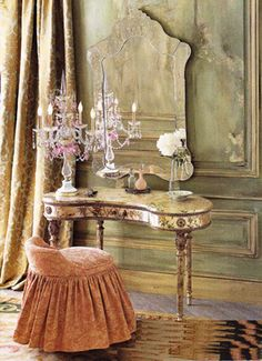 Stunningly beautiful distressed walls with antique Italian dressing table and vintage Venetian glass mirror.