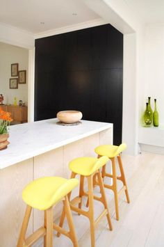 12 Kitchen Counters: This kitchen, with its swathe of black, pops of yellow, and use of different woods, captures the Australian urban coastal style. It's an older building, updated by Diane Fernandes, who retained its charm, but gave it a hip look.