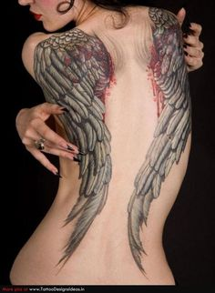Full back tattoo with broken wings