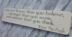 "WINNIE THE POOH Quote Sign, Baby Nursery- ""You are braver than you believe, stronger than you seem and smarter than you think"". $28.00, via Etsy."