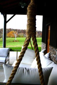 diy giant porch swing on barn gardenista