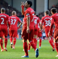 Luis Suarez celebrated committing his long-term future to Liverpool by firing two more goals and sending the Reds to the Barclays Premier League summit with a 3-1 victory over Cardiff City.