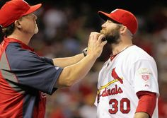 What's in the Cards for the 2012 Bullpen? Hitting Coach Mark McGwire gives Jason Motte a beard massage. Yup. Whatever it takes!
