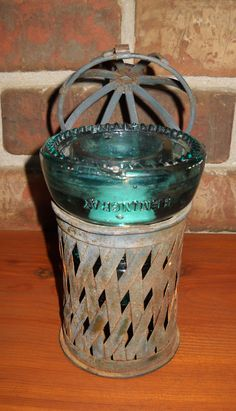 Hemingray № 40 dark aqua antique glass insulator tea light.