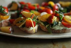 // peach and tomato crostini with basil lemon ricotta