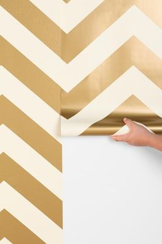 DIY wallpaper for $98. We love the idea of papering just an accent wall.