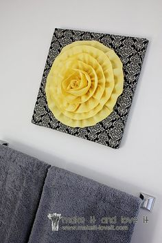 wall hanging. make frame or use pre-made canvas. cover w/fabric, make flower. great flower tutorial.