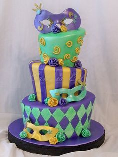 Mardi Gras Wedding Shower Cake with Masks and Roses made of fondant and gumpaste.