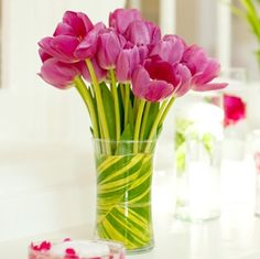 Pretty, simple. I'd like to see it with varigated tulips.     Google Image Result for https://www.independentfloralnetwork.com/profiles/hollyhocksfinefloralandgiftsllc/products/spring%2520flowers/spring3.jpg