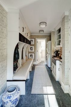 Mud & laundry.  Open lockers, wash station, grasscloth, slate flooring
