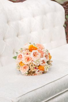 orange and peach bouquet, photo by Amalie Orrange Photography http://ruffledblog.com/sangria-inspired-wedding-ideas #flowers #weddingbouquet