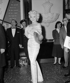 Marilyn Monroe at the Astor Theatre in New York, for the premiere of East of Eden, photographed by Sam Shaw - March 5th, 1955.