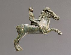 EQUESTRIAN EVENTING. Appliqué of a Horse and Rider, Greek, 525-500 B.C. Bruce White Photography. Gift of Barbara and Lawrence Fleischman