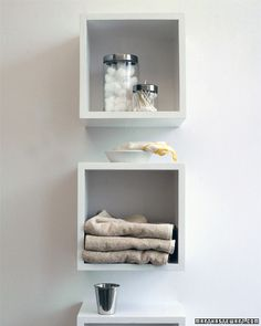 Keep bathroom items neat and accessible with cubbyhole shelves for large items and surgical jars for small toiletries and accessories