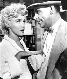 Marilyn Monroe on the set of The Seven Year Itch with co-star, Tom Ewell, 1955.