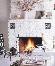 Painted River Rock Fireplace! Love the idea for my own fireplace :)