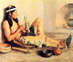 Southwestern Native American Flute Player tying accents on his NAF.