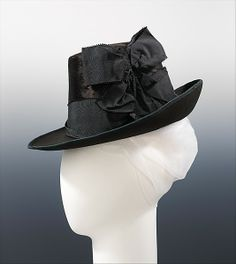 Hat 1885, French, Made of silk ,wool, and fur ~~~~~ The style of this hat is based on men's headwear. The crown shape was popular in the 1880s. The hat matches well with the English tailor-made suit, a form that gained popularity at this time because it accommodated an increasingly active lifestyle. The medium, beaver was a sought after-material for millinery in the 19th century, preferred for its luster and elegant appearance.