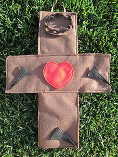 Felt cross with nails, crown of thorns & heart.  A teaching tool to use with kids while telling the Easter story.