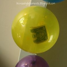 One dollar for each year in separate balloons.  Then they pop them after cake and presents. What a great birthday idea! From Increasingly Domestic blog.
