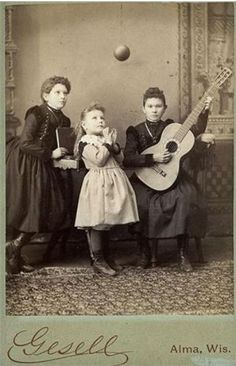 ca. 1860-1900, [carte de visite portrait of three young ladies; one plays the guitar, another looks at the ball suspended in the air], Gesell