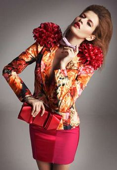 Fabulous Floral. Love the bold flower power shoulder pads!