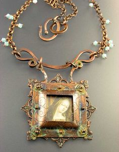 Copper-Madonna by Nancy L T Hamilton  - Copper, Glass, Polymer Clay Image transfer, Swarovski crystals, patinas. Techniques, forging, roller printing, piercing, riveting, fancy wire.