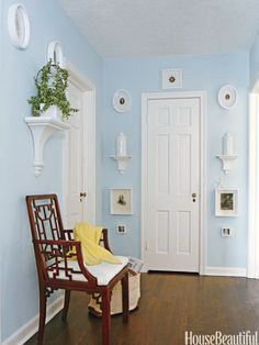 A blue and white color scheme brightens this hallway.