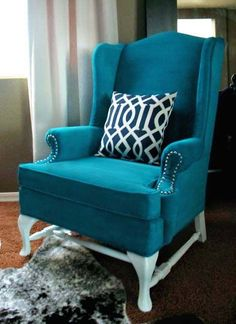 She painted the upholstery!  This opens up a whole new world of possibilities for ugly furniture!