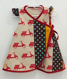 Adorable. Need to get my hands on some of that fabric-- may be a Spoonflower project.