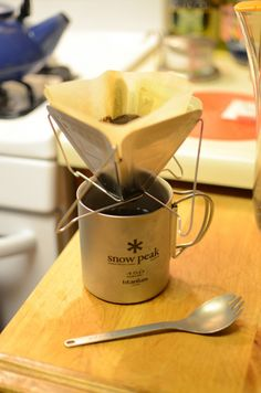 It's sort of pathetic that I have started to bring the gram-shaving mentality of ultralight backpacking into the kitchen. Just ordered this Snow Peak fold-down coffee dripper.