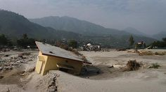 Silt and debris from the flooded river reach the rooftops of buildings in Uttarakhand, June 2013 Posted by floodlist.com