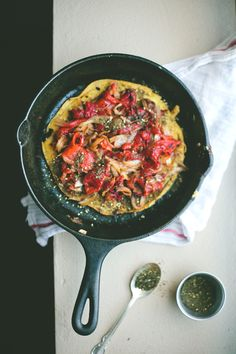 Chickpea Skillet Cake with Za'atar, Caramelized Onions, and Roasted Red Peppers.
