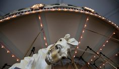 The Hampton Carousel, which dates to 1920, includes 48 hand-carved wooden horses. (Photo by Kaitlin McKeown/Daily Press)