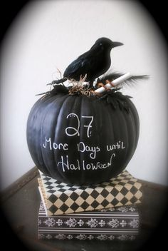 Halloween countdown - paint pumpkin with  chalkboard paint & count away the days! Stack on books covered in black/white pattered papers; add faux crow to top.