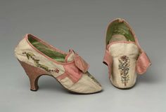 Pair of woman's shoes, European, 1780–85. White figured silk upper embroidered with polychrome silk and silver yarns and spangles in conventional floral sprigs on instep and along sides; pink silk satin latchets cross over square tongue (no buckle); pink silk binding at top and over side and back seams. Round toe. Pink satin covered Louis heel embroidered like upper at back, top piece. Leather sole. Plain cotton insole, green silk damask lining in floral motif. MFA, Boston
